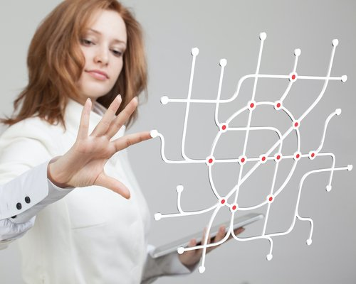Woman touching picture of a network to adjust it